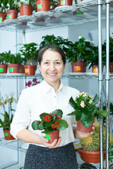 woman in flower shop with kalanchoe