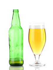 Glass of beer with bottle isolated on white