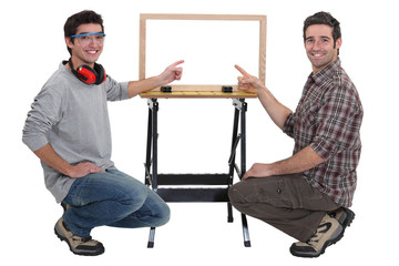 duo of carpenters all smiles