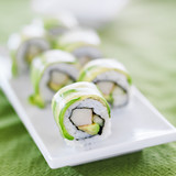Fototapety Sushi - Dragon roll with avocado and crab meat