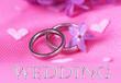 Beautiful wedding rings on pink background