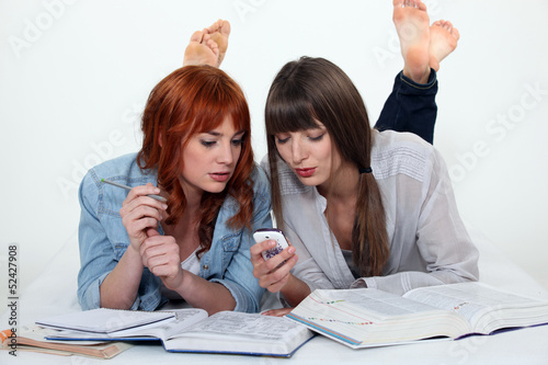 Two young women studying