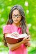 Woman glasses holds book