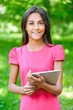 dark-haired young woman with e-book