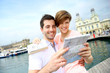 Couple reading touristic map in Barcelona