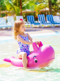 Little girl have fun in aquapark