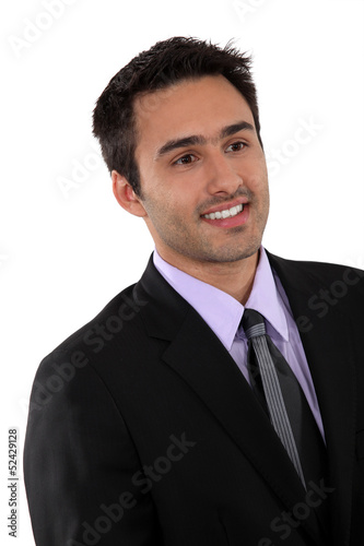 Portrait of smiling man in a suit
