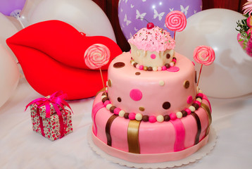 Wonderful birthday cake over balloons background
