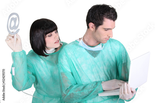 Surgeon and assistant