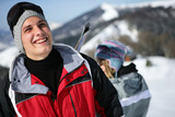 Young man in a red ski jacket