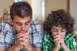 Brothers praying at home
