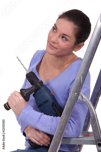 Woman holding a screwdriver