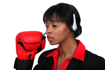 Woman with audio helmet and boxing gloves