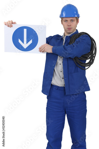 Menacing traffic guard holding a sign