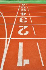numbers on running tracks of outdoor athletic stadium