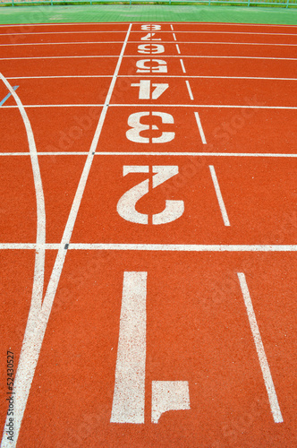 numbers on running tracks of outdoor athletic stadium