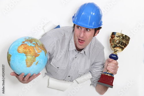 Laborer with globe and cup in hands