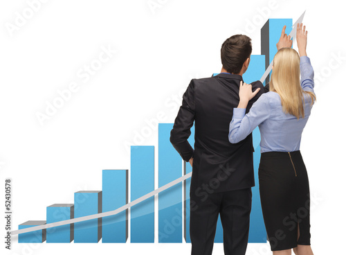 man and woman working with 3d graphics