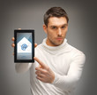 man pointing at tablet pc with email icon
