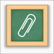 Blackboard with icon of a paper clip