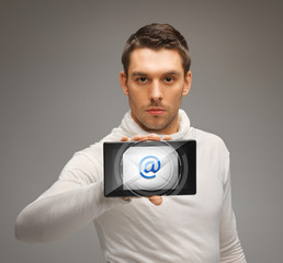 man holding tablet pc with email icon