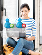 girl with laptop and contact icons
