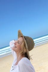 Woman walking along beach