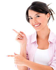 Casual woman pointing to the side
