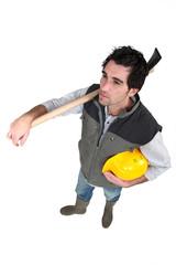 Workers with helmet in hand