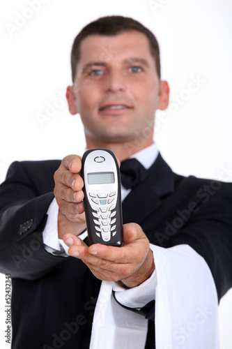 Waiter showing phone