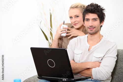 Couple relaxing at home on a Sunday morning