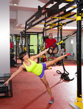 Fototapety Fitness TRX training exercises at gym woman and man