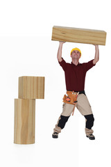 Carpenter lifting wood