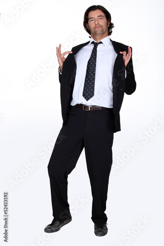 Businessman holding jacket open