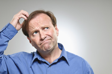 Mature Caucasian Man Scratching Head