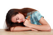 woman sleeping on a table and holding a paint brush