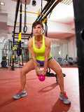 Fototapety Crossfit fitness Kettlebells swing exercise workout at gym