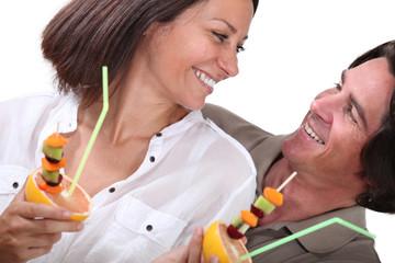 Couple eating fruit
