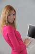 Redhead using laptop