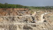 Production of a natural construction stone in an open pit.