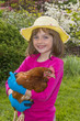 little girl holding a hen