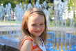 little sympathetic girl on the background of fountains