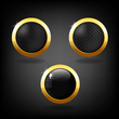 Set of three black and gold buttons.
