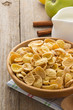 bowl of corn flakes  on wood