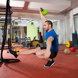 Fototapety Crossfit fitness man balance Kettlebells with one leg