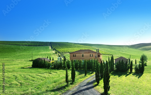 Tuscany landscape with typical farm house, Italty
