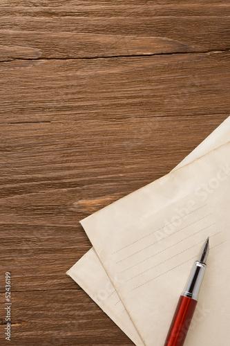 ink pen and old postal envelope