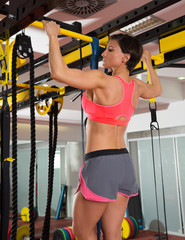 Crossfit fitness toes to bar man pull-ups 2 bars with TRX