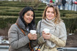 Two Young Women with Hot Beverage