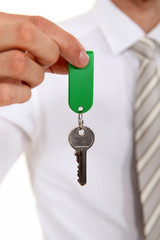 Estate agent holding house key
